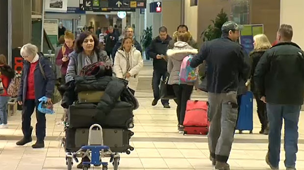 About 50 flights to, from Lambert canceled because of East Coast storm