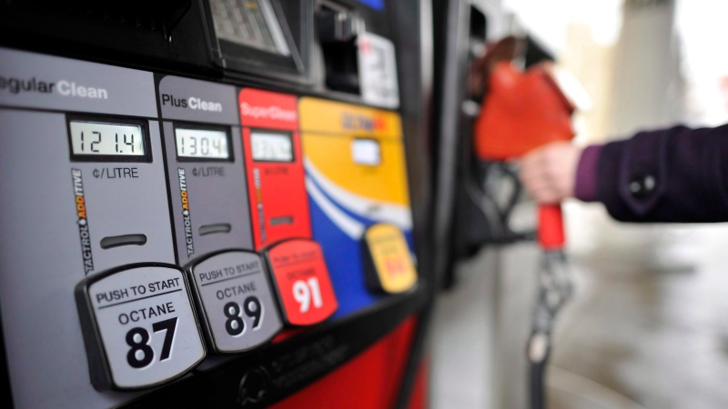 A motorist reaches for the pump at a gas station in Toronto on Thursday, February 24, 2011. (THE CANADIAN PRESS/Patrick Dell)