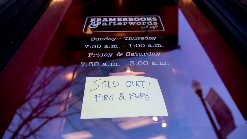 "Sign posted at the door for Kramerbooks & Afterwords Cafe indicating that the book ""Fire and Fury: Inside the Trump White House"" is sold out at the bookstore located in the Dupont Circle neighborhood in Washington, Jan. 5, 2018. (AP Photo/Pablo Martinez Monsivais)"
