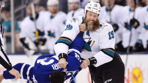 San Jose Sharks' Joe Thornton, right, fights with Toronto Maple Leafs' Nazem Kadri during first period NHL hockey action, in Toronto on Thursday, January 4, 2018. (THE CANADIAN PRESS/Frank Gunn)