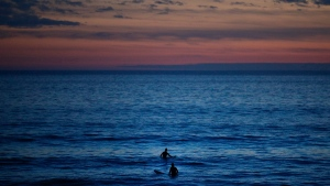 Two surfers wait for a wave in the Pacific Ocean at Sunset Beach in Pacific Palisades, Calif., Thursday, Jan. 4, 2018. (THE CANADIAN PRESS/AP/Jae C. Hong)