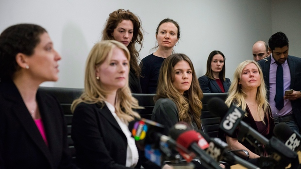 Lawyers Alexi Wood (left) and Tatha Swann (second from left) and plaintiffs Hannah Miller, Patricia Fagan, Diana Bentley and Kristin Booth attend a press conference after filing lawsuits alleging sexual harassment by Soulpepper Theatre Company director Albert Schultz, in Toronto, on Thursday, January 4, 2018. THE CANADIAN PRESS/Christopher Katsarov