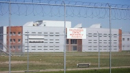 A sign marks the perimeter of the Regina Correctional Centre on Monday Aug. 25, 2008. THE CANADIAN PRESS/Troy Fleece