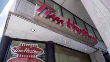 "A Tim Hortons coffee shop is shown in Toronto on Wednesday, June 29, 2016. Tim Hortons' Canadian headquarters has waded into a brewing controversy stemming from this week's minimum wage hike in Ontario, calling the elimination of paid breaks and benefits for employees at certain locations ""reckless"". THE CANADIAN PRESS/Eduardo Lima"