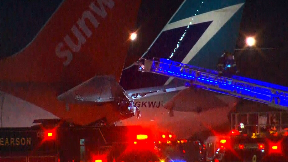 Damage to the tail of a Sunwing aircraft following a collision is seen at Toronto Pearson International Airport on Friday, January 5, 2018.
