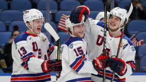 United States teammates celebrate a goal during the second period in the bronze medal game of the world junior hockey championships against the Czech Republic, Friday, Jan. 5, 2018, in Buffalo, N.Y. (AP Photo/Jeffrey T. Barnes)