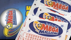 In this July 1, 2016, file photo, Mega Millions lottery tickets rest on a counter at a Pilot travel center near Burlington, N.C. (AP Photo/Gerry Broome, File)