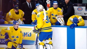 Sweden goaltender Filip Gustavsson (30) and teammates react as Canada celebrates their victory in gold medal game IIHF World Junior Championship hockey action in Buffalo, N.Y. on Friday, January 5, 2018. THE CANADIAN PRESS/Frank Gunn