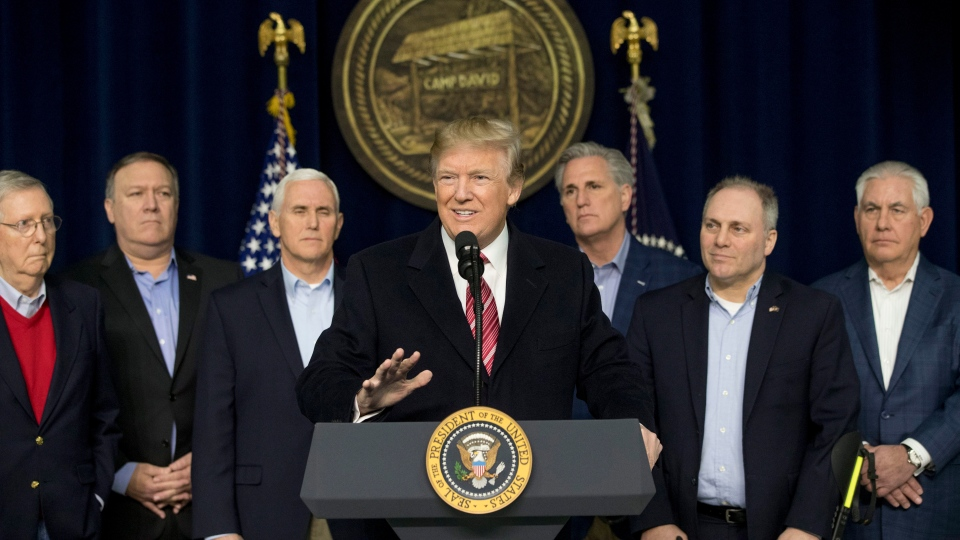 U.S. President Donald Trump, center, accompanied by from left, Senate Majority Leader Mitch McConnell of Ky., Vice President Mike Pence, House Majority Leader Kevin McCarthy of Calif., House Majority Whip Steve Scalise, R-La., Secretary of State Rex Tillerson, speaks after participating in a Congressional Republican Leadership Retreat at Camp David, Md., Saturday, Jan. 6, 2018. (AP Photo / Andrew Harnik)