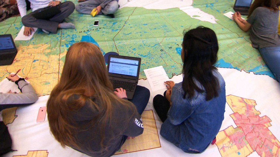 Students at Georgina, Ont.'s Sutton District High School study Canada's democracy with the help of the Route 338 map. (CTV News)