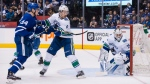 Toronto Maple Leafs centre Auston Matthews (34) is challenged in front of the net by Vancouver Canucks defenceman Michael Del Zotto (4) as goaltender Jacob Markstrom (25) watches the play during second period NHL hockey action in Toronto on Saturday, January 6, 2018. THE CANADIAN PRESS/Christopher Katsarov