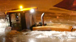 A city worker in Montreal was rescued after his tractor fell through the ice while clearing snow.