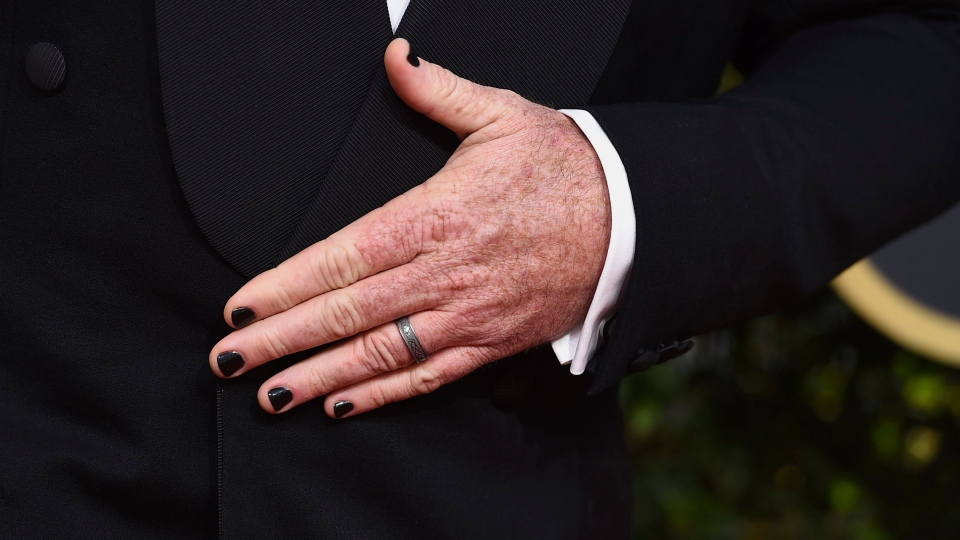 Chris Sullivan wears black nail polish as he arrives at the 75th annual Golden Globe Awards at the Beverly Hilton Hotel on Sunday, Jan. 7, 2018. (Photo by Jordan Strauss/Invision/AP)