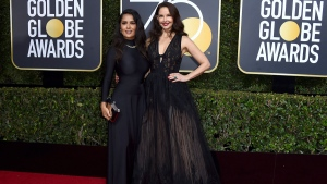 Salma Hayek, left, and Ashley Judd arrive at the 75th annual Golden Globe Awards at the Beverly Hilton Hotel on Sunday, Jan. 7, 2018, in Beverly Hills, Calif. (Photo by Jordan Strauss/Invision/AP)
