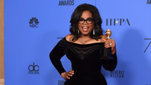 Oprah Winfrey poses in the press room with the Cecil B. DeMille Award at the 75th annual Golden Globe Awards at the Beverly Hilton Hotel on Sunday, Jan. 7, 2018. (Photo by Jordan Strauss/Invision/AP)