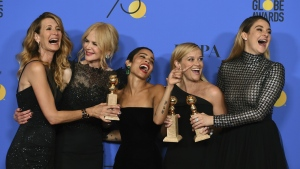 "Laura Dern, from left, Nicole Kidman, Zoe Kravitz, Reese Witherspoon and Shailene Woodley pose in the press room with the award for best television limited series or motion picture made for television for ""Big Little Lies"" at the 75th annual Golden Globe Awards at the Beverly Hilton Hotel in Beverly Hills, Calif. on Sunday, Jan. 7, 2018. (Jordan Strauss / Invision)"