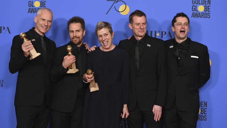 The cast and crew of 'Three Billboards Outside Ebbing, Missouri' from left, Martin McDonagh, winner of the award for best screenplay - motion picture, Sam Rockwell, winner the award for best performance by an actor in a supporting role in any motion picture, Frances McDormand, winner of the award for best performance by an actress in a motion picture - drama, and Graham Broadbent and Peter Czernin, pose in the press room with the award for best motion picture - drama at the 75th annual Golden Globe Awards at the Beverly Hilton Hotel on Sunday, Jan. 7, 2018. (Jordan Strauss / Invision)