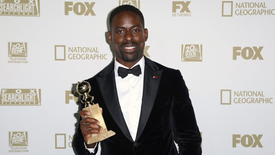 Sterling K. Brown poses with the award for best performance by an actor in a television series - drama for 'This Is Us' arrives at the FOX Golden Globes afterparty at the Beverly Hilton Hotel on Sunday, Jan. 7, 2018, in Beverly Hills, Calif. (Photo by Willy Sanjuan/Invision/AP)
