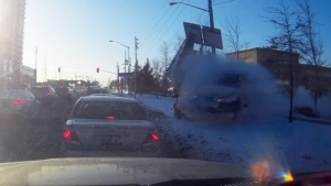 A sedan plows through snow before striking cars waiting at a light in this image from dashcam video recorded in Vaughan, Ont., on Jan. 6, 2018.
