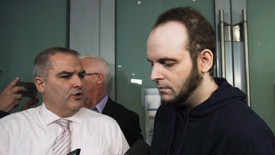 Joshua Boyle speaks to the media after arriving at the airport in Toronto on Friday, October 13, 2017. Boyle was arrested by Ottawa police late last month and made his first court appearance on New Year's Day facing 15 charges, including eight counts of assault, two of sexual assault, two of unlawful confinement and one count of causing someone to take a noxious thing. (Nathan Denette / THE CANADIAN PRESS)