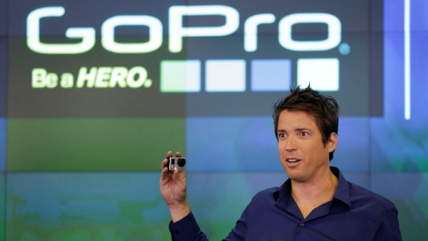 In this Thursday, June 26, 2014, file photo, GoPro CEO Nick Woodman celebrates his company's IPO at the Nasdaq MarketSite in New York. (AP Photo/Seth Wenig, File)