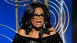 This image released by NBC shows Oprah Winfrey accepting the Cecil B. DeMille Award as presenter Reese Witherspoon looks on, right, at the 75th Annual Golden Globe Awards in Beverly Hills, Calif., on Sunday, Jan. 7, 2018. (Paul Drinkwater/NBC via AP)