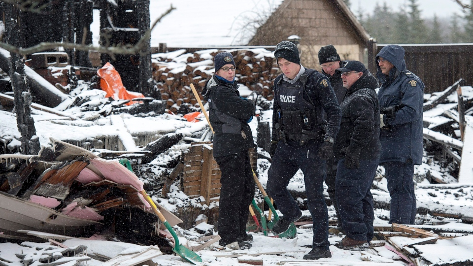 RCMP officers and a representative of the Medical Examiner's office search the scene of a house destroyed in a fatal fire in Pubnico Head, N.S. on Monday, Jan. 8, 2018. (THE CANADIAN PRESS/Andrew Vaughan)