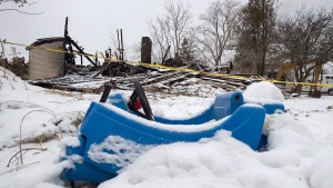 A toy car is seen on the property of a house destroyed in a fatal fire in Pubnico Head, N.S. on Monday, Jan. 8, 2018. (THE CANADIAN PRESS/Andrew Vaughan)