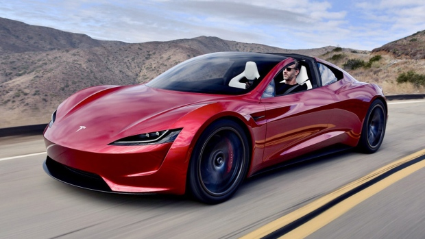 On The Road New Tesla Roadster With Designer Behind The