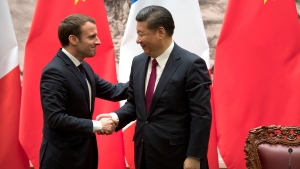 French President Emmanuel Macron, left, and Chinese President Xi Jinping shake hands after a joint press briefing at the Great Hall of the People in Beijing, Tuesday, Jan. 9, 2018. (AP / Mark Schiefelbein, Pool)