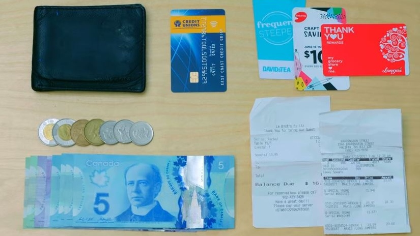 Atlantic Canada's credit unions took 12 wallets loaded with receipts, bus tickets, a credit union debit card and about $100 cash -- and left them in public places across the four provinces. (Atlantic Credit Unions/YouTube)