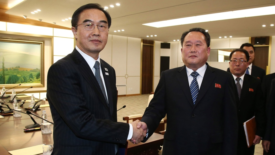 South Korean Unification Minister Cho Myoung-gyon, left, shakes hands with the head of North Korean delegation Ri Son Gwon after their meeting at the Panmunjom in the Demilitarized Zone in Paju, South Korea, Tuesday, Jan. 9, 2018. (Korea Pool via AP)