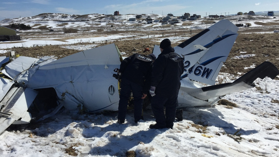Transportation Safety Board of Canada investigators examine the site of crash that killed former MP Jean Lapierre and six others, in Iles-de-la-Madeleine, Quebec. (TSB / Flickr)