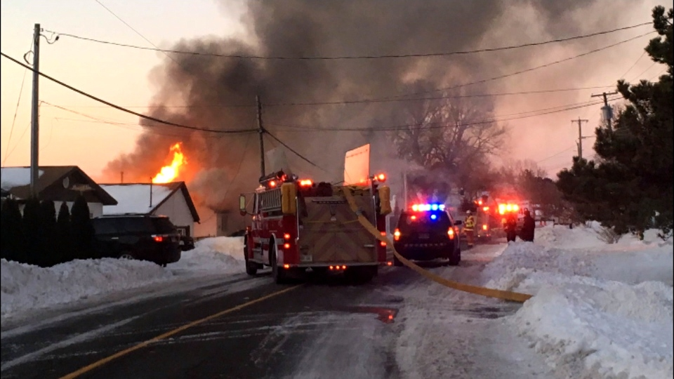 Firefighters are shown at the scene of a fatal fire in Brighton on Wednesday morning. (Submitted)
