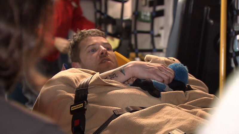 An injured skier is loaded into an ambulance after being rescued from the backcountry in Mount Seymour Provincial Park.