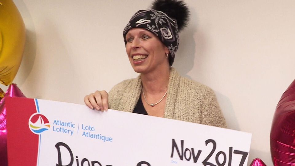 Diane Bishop holds up her cheque for $1.5-million after she won a lottery in November 2017. Bishop, a convenience store operator in Newfoundland, died Tuesday, Jan. 9, 2018, surrounded by loved ones.