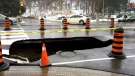 A large sinkhole in the area of Yonge Street and Highway 401 is seen.