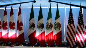 "National flags representing Canada, Mexico, and the U.S. are lit by stage lights at the North American Free Trade Agreement, NAFTA, renegotiations, in Mexico City, Tuesday, Sept. 5, 2017. Canada and Mexico may have taken a hard line against the so-called American ""poison pills"" in the acrimonious North American Free Trade talks. THE CANADIAN PRESS/AP/Marco Ugarte"
