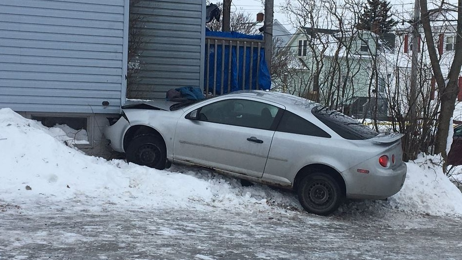 Cape Breton Regional Police say a car struck a woman before crashing into a home on St. Peter's Road in Sydney, N.S. on Jan. 11, 2018.