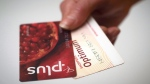 A Loblaws PC Plus and a Shoppers Drug Mart Optimum card are shown together in Toronto on Tuesday. Nov. 7. (THE CANADIAN PRESS/Graeme Roy)