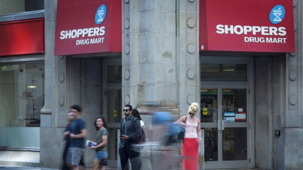 People pass by a Shoppers Drug Mart in downtown Toronto on Monday, July 15, 2013. (THE CANADIAN PRESS/Graeme Roy)