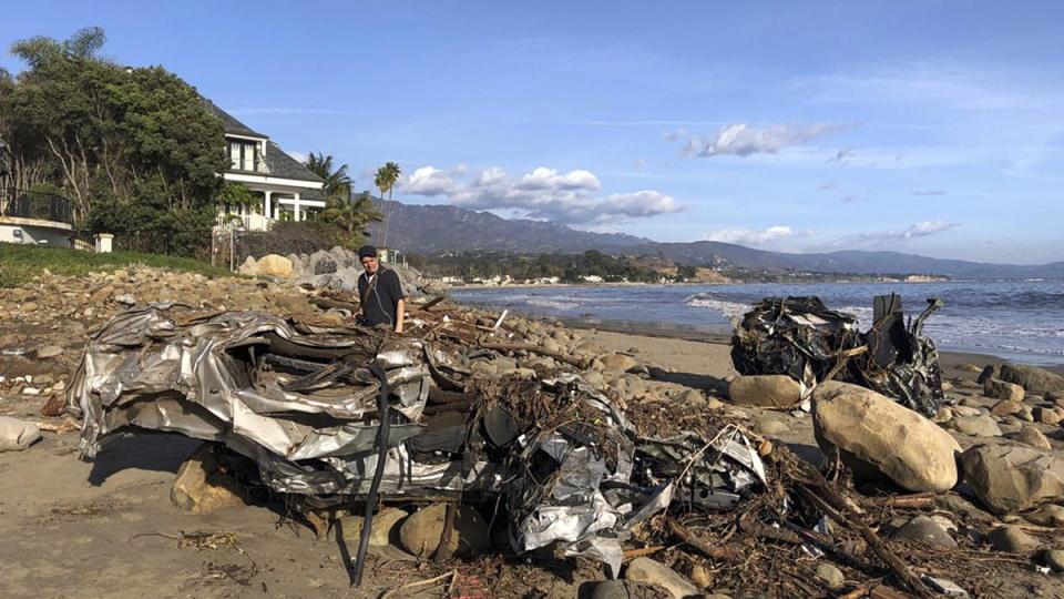 The wreckage of two autos on the beach that were carried by floodwaters down Montecito Creek all the way to the Pacific Ocean in Montecito, Calif., on Jan. 10, 2018. (Mike Eliason/Santa Barbara County Fire Department via AP)