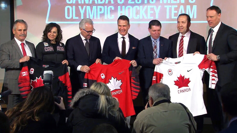 Hockey Canada officials hold up Team Canada jerseys after unveiling the men's team roster for the 2018 Pyeongchang games.