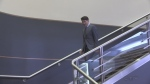 Justin Trudeau walks down the stairs at the London Convention Centre