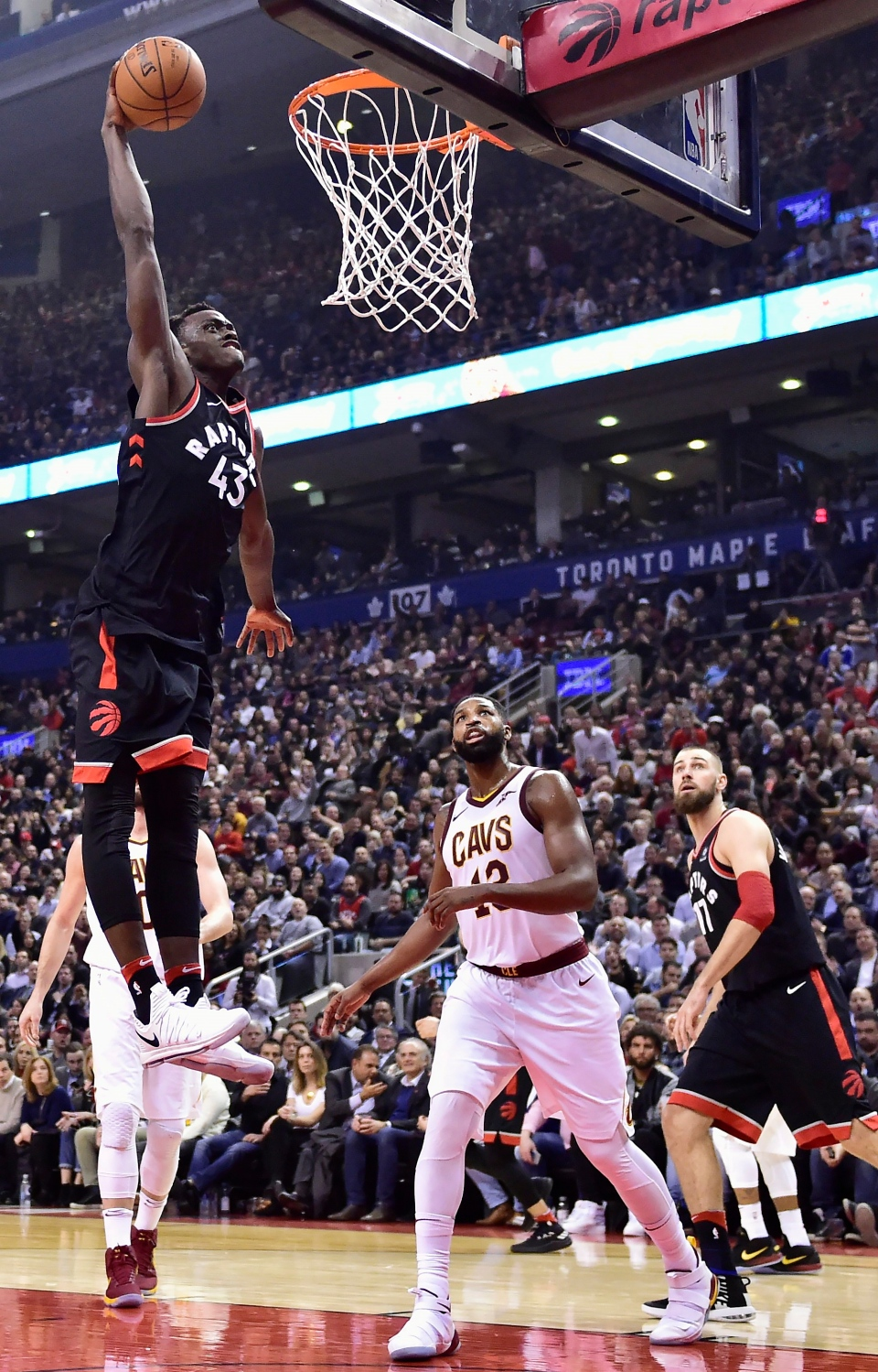 Toronto Raptors forward Pascal Siakam (43) slams the ball past Cleveland Cavaliers centre Tristan Thompson (13) as Raptors centre Jonas Valanciunas (17) during first half NBA basketball action in Toronto on Jan. 11, 2018. THE CANADIAN PRESS/Frank Gunn