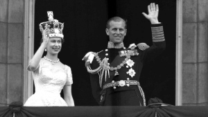 Queen Elizabeth II and Prince Philip, Duke of Edinburgh, on the balcony at Buckingham Palace, following her coronation at Westminster Abbey on June 2, 1953. (Leslie Priest / AP)