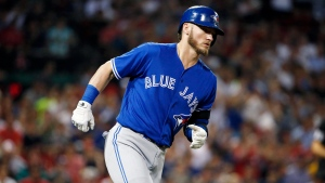 Toronto Blue Jays' Josh Donaldson rounds first base on his solo home run during the third inning of a baseball game against the Boston Red Sox in Boston, Sept. 26, 2017. (AP Photo/Michael Dwyer)