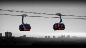 <b>Gondola over the North Saskatchewan River</b></br> <br><b>By:</b> Gary and Amber Poliquin</br> <br><b>Proposal:</b> To connect downtown Edmonton and Old Strathcona via a gondola.</br> <br><b>What:</b> A gondola between the two pedestrian centres, connected by three stations.</br> <br><b>Where:</b>  Proposed stations would be at the Shaw Conference Centre, one near RE/MAX Field, and one at the parking lot near the Old Strathcona Farmer's Market.</br>