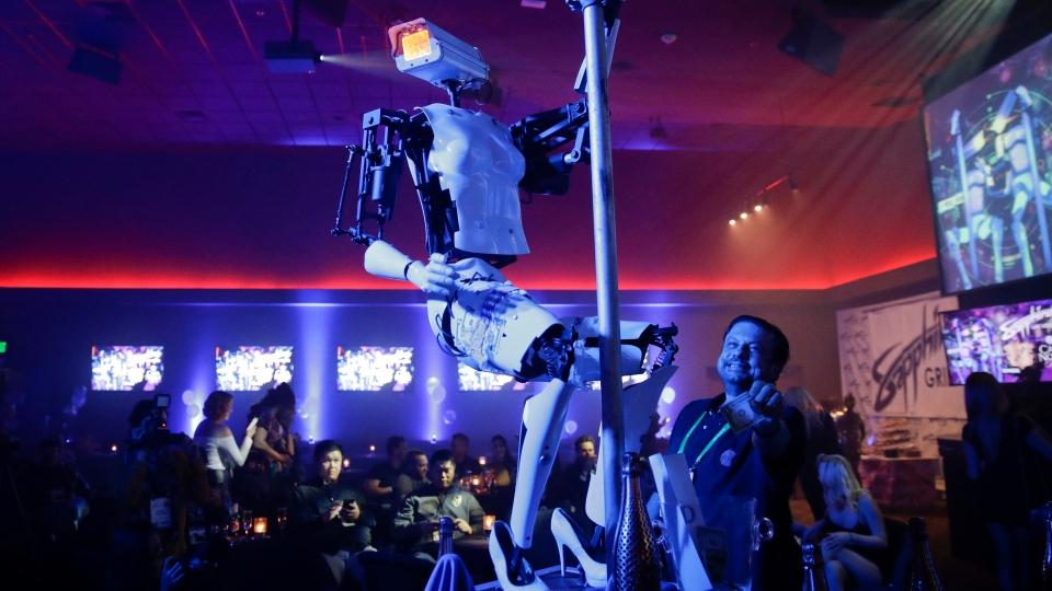A pole-dancing robot built by British artist Giles Walker performs at a gentlemen's club Monday, Jan. 8, 2018, in Las Vegas. (AP Photo/Jae C. Hong)