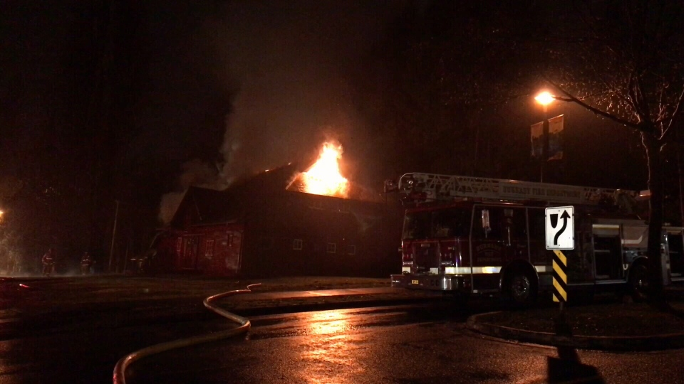 Flames broke out early Friday morning at a heritage building used by the City of Burnaby to store lawn equipment.